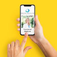 phone in hand dialing functional medicine doctor in denver