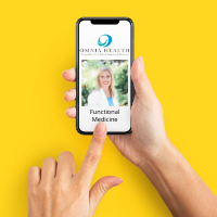 phone in hand dialing functional medicine doctor in denver